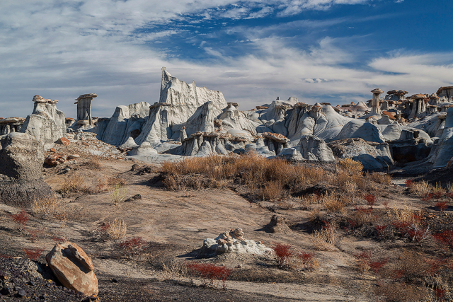 pale rock formations under a blue sky